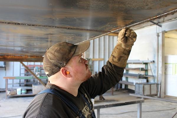 Insta-Space-Storage-Ryan-inspects-welds-in-steel-sub-floor-600px